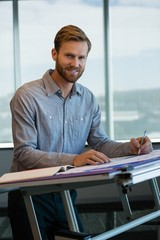 Male architect working in office