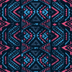 Seamless geometric pattern. Ethnic and tribal motifs. Grunge texture. Print for your textiles. Pink and blue colors.