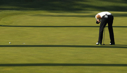 Rory McIlroy of Northern Ireland reacts to missing a par putt on the 10th green during third round play in the 2011 Masters golf tournament in Augusta