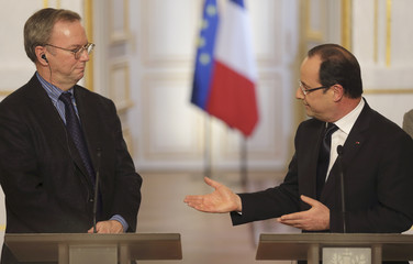 Google Executive Chairman Schmidt and French President Hollande attend a news conference at the Elysee Palace in Paris
