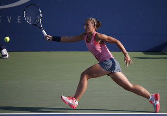 Errani of Italy runs down a return to Rogowska of Australia at the U.S. Open tennis championships in New York