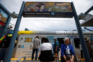 A woman sits on the platform at the Downtown Santa Monica station on L.A. Metro's new $1.5 billion Expo Line extension that connects downtown to the beach for the first time in 63 years, in Santa Monica
