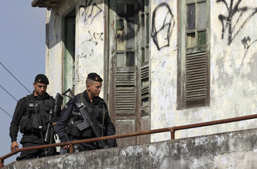 Policemen of BOPE patrol during operation to install UPP in Rio de Janeiro