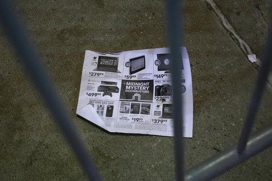 A Midnight Mystery Doorbuster flier is seen outside the Best Buy electronics store in Westbury, New York