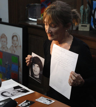 Estela de la Cuadra, who is seeking for her missing family members during the so-called Argentina's 1976s Dirty War shows a photo of her sister Elena and a handwritten letter from then Jesuit leader Jorge Bergoglio, now Pope Francis in Buenos Aires