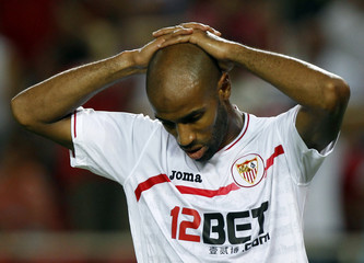 Sevilla's Frederic Kanoute reacts after missing a scoring opportunity against Deportivo Coruna in Seville
