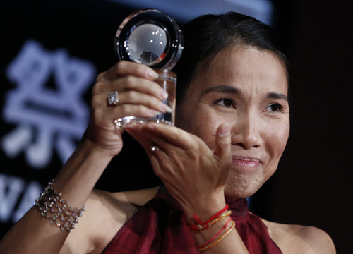 """Director Kulikar holds her prize for the Spirit of Asia Award by the Japan Foundation Asia Center for her film """"The Last Reel"""" during the closing ceremony of the Tokyo International Film Festival in Tokyo"""