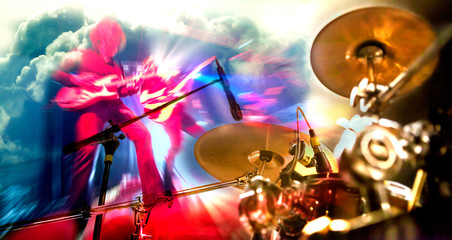 Stage lights.Double exposure abstract musical background.Playing guitar and concert concept.