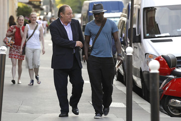 French Football Federation member Martel and former French soccer player Thuram arrive to attend a council meeting at the FFF headquarters in Paris
