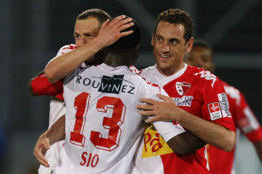 FC Sion's Sio celebrate with his team mates Vanczak and Rodrigo after wining their Swiss Cup semi-final soccer match against FC Biel in Sion