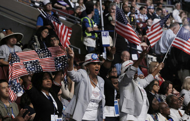 Delegates cheer as members of the Congressional Black Caucus take the stage at the Democratic National Convention in Philadelphia