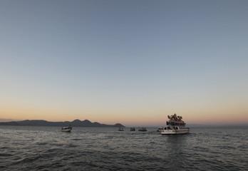 "People on ships celebrate ""La Purisima"" along Xolotlan Lake in Managua City"