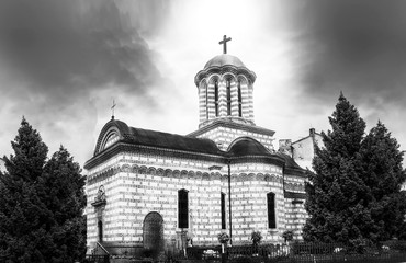 Orthodox Christian Church with dark clouds and light