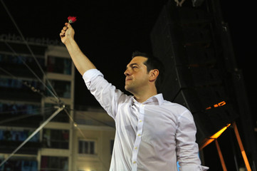 Head of Greece's radical left SYRIZA party Tsipras waves to supporters during pre-election rally in Athens