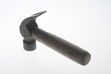 TOP VIEW OF A HAMMER ON A WHITE BACKGROUND.