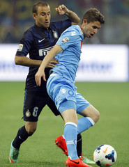 Inter Milan's Palacio  fights for the ball with Napoli's Jorginho during their Italian Serie A soccer match in Milan