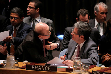 Chinese Permanent Representative to the United Nations Liu speaks with Permanent Representative of France to the United Nations Delattre before the United Nations Security Council voted on a resolution in South Sudan at the United Nations in New York