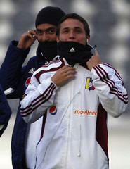 Venezuela's Seijas and Arango stand on the pitch during their visit to the Ciudad de La Plata stadium ahead of their Copa America soccer match against Brazil in La Plata