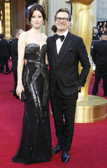 """Gary Oldman, best actor nominee for his role in """"Tinker Tailor Soldier Spy"""", and his wife Alexandra Edenborough arrive at the 84th Academy Awards in Hollywood"""