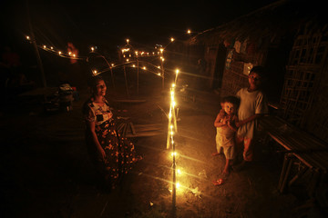 Buddhist Rakhine people displaced by violence light candles during the Festival of Lights at a monastery that is used as a refugee camp in Sittwe