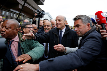 French politician Alain Juppe, current mayor of Bordeaux, a member of the conservative Les Republicains political party and candidate for their presidential primary, visits the esplanade of Argenteuil