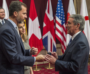 Busto, president of Spanish Federation of Food Banks, receives his badge from Spain's Crown Prince Felipe and Princess Letizia during a reception for the Prince of Asturias Awards winners in Oviedo