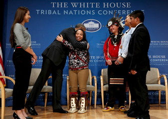 Obama hugs Ticknor after taking part in the annual White House Tribal Nations Conference in Washington