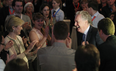 Quebec's Premier Jean Charest smiles before his final speech at the Liberal Party general council meeting at the Victorin hotel in Victoriaville