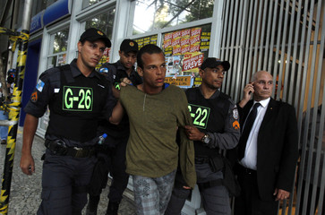 Police officers detain a demonstrator during the teacher's strike in Rio de Janeiro