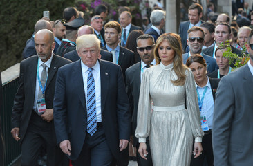 U.S. President Donald Trump and First Lady Melania Trump arrive for a concert of La Scala Philharmonic Orchestra during the Heads of State and of Government G7 summit in Sicily