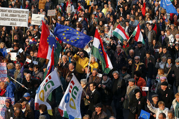 Anti-government demonstrators march during the Hungary's National Day in Budapest