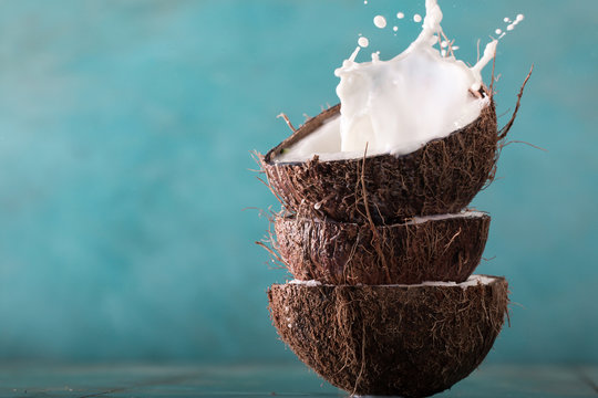 Coconut and coconut vegan milk non dairy on blue background with copy space