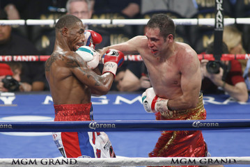 J'Leon Love (L) of the U.S. takes a punch from Marco Antonio Periban of Mexico during their super middleweight fight at the MGM Grand Garden Arena in Las Vegas