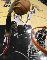 Miami's LeBron James dunks for two points against the San Antonio Spurs during Game 5 of their NBA Finals