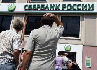 People stand in a line to get into a branch of Sberbank of Russia bank in Donetsk