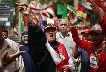 Protesters shout during a protest against candidate Ahmed Shafiq at Tahrir Square in Cairo