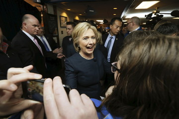 Clinton greets supporters in the crowd during a campaign stop at the Adel Family Fun Center bowling alley in Adel