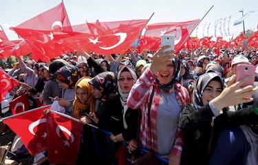 Supporters Turkey's President Erdogan wave national flags in Istanbul, Turkey