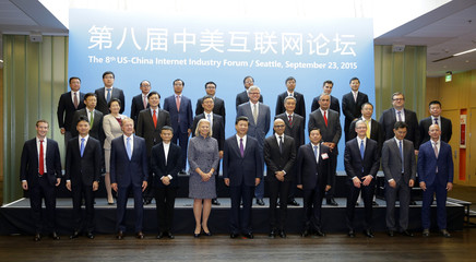 Chinese President Xi Jinping poses for a photo with a group of CEOs and other executives at Microsoft's main campus in Redmond Washington