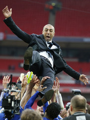 Chelsea's coach Roberto Di Matteo is thrown in the air by players after their FA Cup final soccer match against Liverpool at Wembley Stadium in London