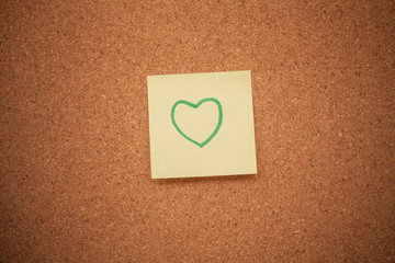 Heart note on cork board