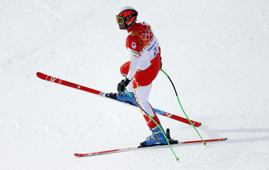 Canada's Jan Hudec stands on the slope during the men's alpine skiing downhill race at the 2014 Sochi Winter Olympics