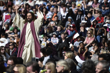 Actor James Burke-Dunsmore portrays Jesus during the Wintershall Players' production The Passion of Jesus, at Trafalgar Square in London