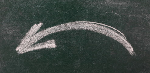 Curved arrow pointing to the left chalkboard, blackboard texture