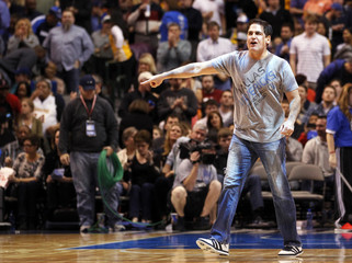 Dallas Mavericks owner Mark Cuban reacts at the end of the first half against the Los Angeles Lakers during their NBA basketball game in Dallas, Texas