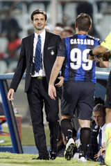 Inter Milan's coach Stramaccioni smiles as Cassano leaves the field during their Italian Serie A soccer match against Pescara in Pescara