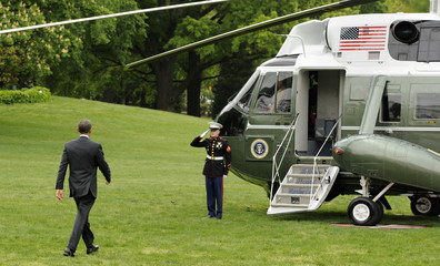U.S. President Obama walks to Marine One helicopter as he departs for a day trip to Columbus, Ohio, to deliver the commencement address at Ohio State University, the White House in Washington