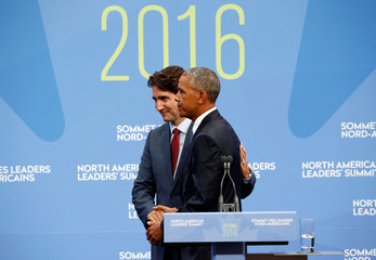 Obama takes part in a press conference at the North American Leaders' Summit in Ottawa, Canada