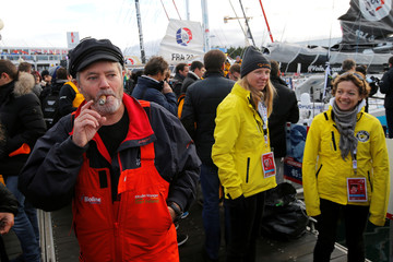 Skippers Enda O'Coineen of Ireland smokes a cigar just before leaving Les Sables d'Olonne, on France's Atlantic coast, to start in the Vendee Globe sailing race