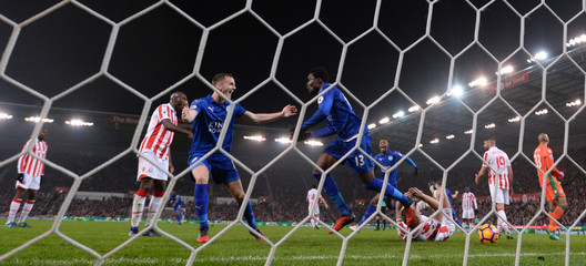 Leicester City's Ahmed Musa celebrates scoring their second goal with Andy King
